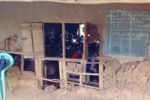 The Water Project: Irenji Primary School -  Students In Class With Crumbling Walls