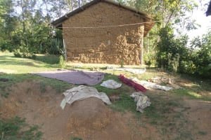 The Water Project: Emusanda Community, Walusia Spring -  Clothes Drying On Ground