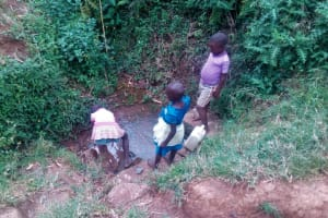 The Water Project: Maganyi Primary School -  Fetching Water