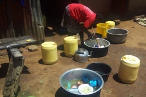 The Water Project: Shibale Primary School -  Cook Washing Utensils At Kitchen