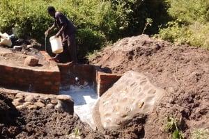 The Water Project: Shiamboko Community, Oluchinji Spring -  Curing Cement