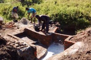 The Water Project: Shiamboko Community, Oluchinji Spring -  Community Members Helping