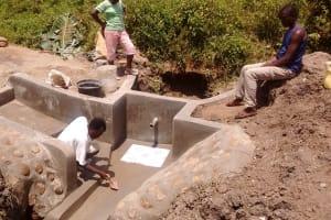 The Water Project: Shiamboko Community, Oluchinji Spring -  Plastering