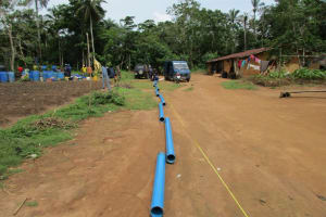 The Water Project: Baya Community -  Measuring Casing