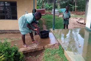 The Water Project: Ebusiratsi Special Primary School -  Student Washing Floor