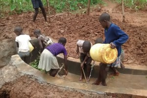 The Water Project: Ebuhando Community, Christopher Omasaba Spring -  Children Cleaning The Spring