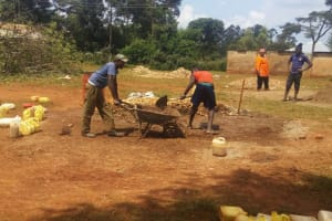 The Water Project: Mwiyenga Primary School -  Parents Delivering Materials