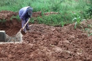 The Water Project: Ebuhando Community, Christopher Omasaba Spring -  Backfilling