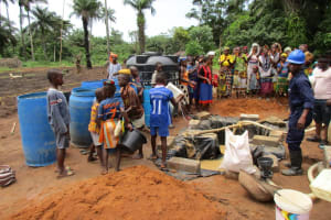 The Water Project: Baya Community -  Delivering Water For Drilling