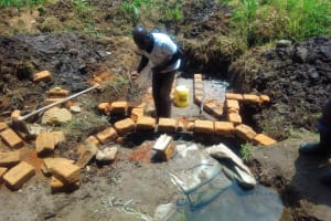 The Water Project: Mungulu Community, Zikhungu Spring -  Spring Construction