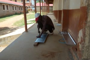 The Water Project: Mwitoti Secondary School -  Artisan Working On Gutters