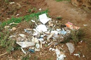 The Water Project: Lwenya Community, Warosi Spring -  Poor Waste Disposal