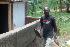 The Water Project: Chandolo Primary School -  Artisan Ogutu Working On The Latrines