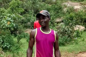 The Water Project: Lwenya Community, Warosi Spring -  Bramwell Amugwiri Working On His Farm