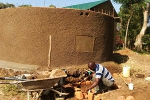 The Water Project: Shiyunzu Primary School -  Artisan Working On Soak Pit