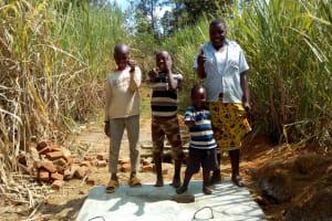 The Water Project: Futsi Fuvili Community, Patrick Munyalo Spring -  Sanitation Platforms