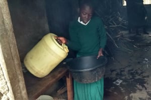 The Water Project: Mulwakhi Primary School -  Girl Getting Water