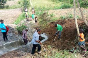 The Water Project: Futsi Fuvili Community, Shikanga Spring -  Backfilling