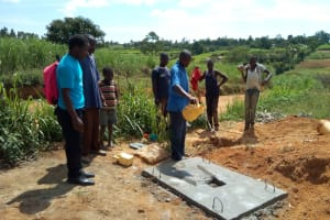The Water Project: Futsi Fuvili Community, Shikanga Spring -  Latrine Construction
