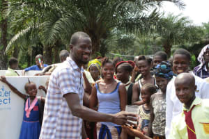 The Water Project: Ernest Bai Koroma Secondary School -  Principal Conteh Giving Clean Water