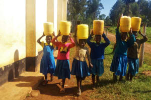 The Water Project: Munyanda Primary School -  Carrying Water