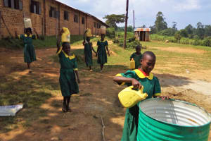 The Water Project: Buhunyilu Primary School -  Girls Bringing Water For Construction