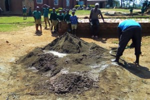 The Water Project: Buhunyilu Primary School -  Mixing Cement
