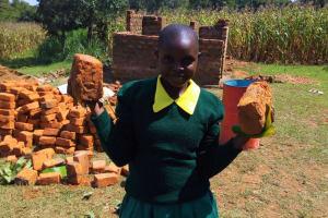 The Water Project: Buhunyilu Primary School -  Carrying Bricks