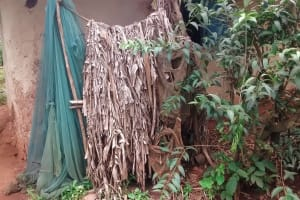 The Water Project: Lwenya Community, Warosi Spring -  Bathing Shelter Made Of Banana Leaves And Mosquito Net