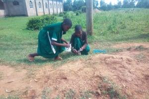 The Water Project: Shilakaya Community, Shanamwevo Spring -  Girls Eating Termites