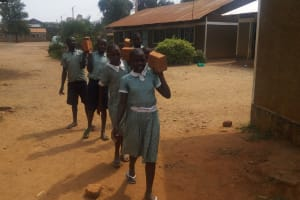 The Water Project: Shibale Primary School -  Carrying Bricks