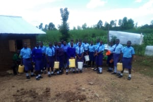 The Water Project: Eshisenye Girls Secondary School -  Girls Posing With Jerrycans