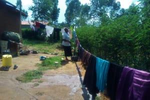 The Water Project: Shilakaya Community, Shanamwevo Spring -  Woman Hanging Laundry