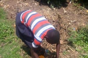 The Water Project: Musango Community, Ham Mwenje Spring -  Community Member Picking Up