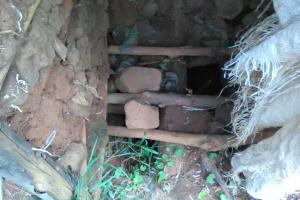 The Water Project: Mwichina Community, Mwichina Spring -  Latrine Floor