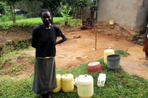 The Water Project: Ejinja Community, Anekha Spring -  Mary By Her Water Containers