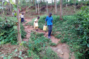 The Water Project: Itukhula Community, Lipala Spring -  Coming To Fetch Water