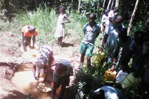 The Water Project: Madivini Primary School -  Fetching Water