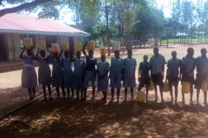 The Water Project: Emmaloba Primary School -  Students With Their Containers
