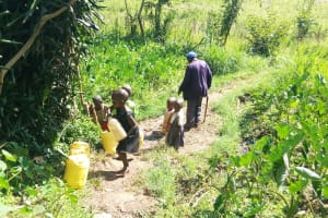 The Water Project: Bukhunyilu Community, Solomon Wangula Spring -  Fetching Water