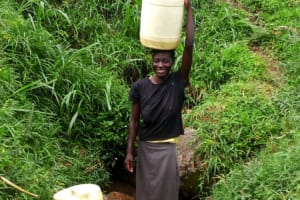 The Water Project: Ejinja Community, Anekha Spring -  Mary At The Spring