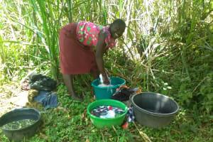 The Water Project: Mwichina Community, Mwichina Spring -  Washing Clothes At Spring