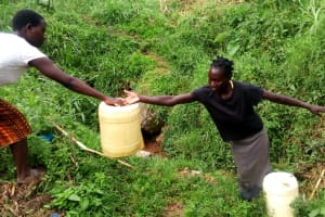 The Water Project: Ejinja Community, Anekha Spring -  Helping Each Other