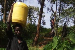 The Water Project: Bukhunyilu Community, Solomon Wangula Spring -  Carrying Water