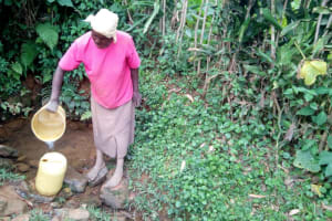 The Water Project: Itukhula Community, Lipala Spring -  Fetching Water