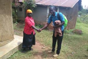 The Water Project: Mwichina Community, Mwichina Spring -  Ann Achango Meeting Samuel Simidi