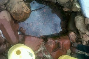 The Water Project: Ulagai Community, Aduda Spring -  Current Water Source