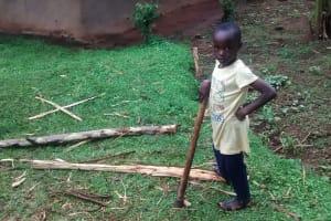 The Water Project: Chandolo Community, Joseph Ingara Spring -  Girl Splitting Firewood