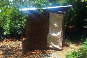 The Water Project: Ulagai Community, Rose Obare Spring -  Mud Latrine