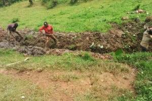 The Water Project: Kakubudu Community, Fred Lagueni Spring -  Digging Drainage